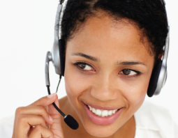 call center operator with headphone smiling