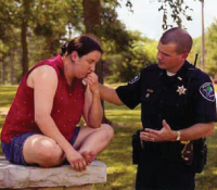 CIT officer comforting a teenager